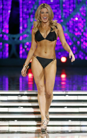 Miss New York Mallory Hytes Hagan competes swimsuit portion of the Miss America pageant on Saturday, Jan. 12, 2013, in Las Vegas. (AP Photo/Isaac Brekken)