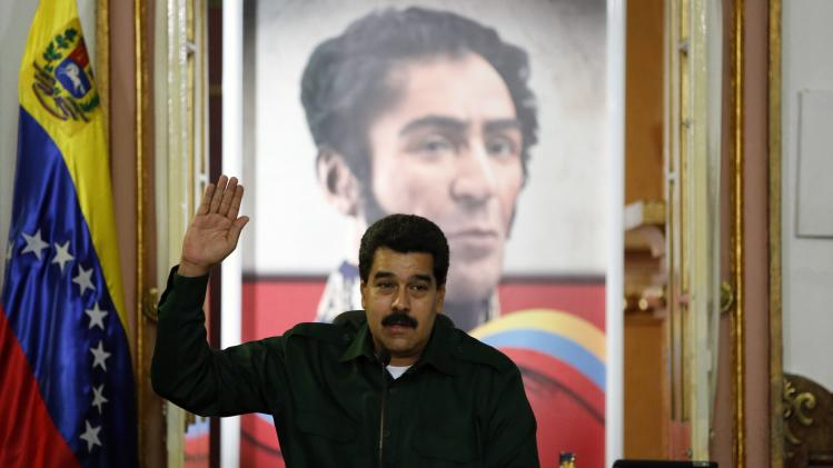 Venezuela's President Nicolas Maduro gestures during a meeting with the opposition's newly elected mayors and governors at Miraflores Palace in Caracas