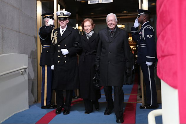 Former U.S. President Jimmy Carter and wife Rosalynn Carter arrive for the presidential inauguration on the West Front of the U.S. Capitol in Washington