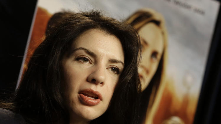 "This Feb. 19, 2013 photo shows author Stephenie Meyer speaking in Miami. Meyer, author of the ""Twilight"" saga says she's working on a new series.  She wrote ""The Host"" as an escape from editing of one of the books in the popular vampire series. The movie adaption of ""The Host"" premieres March 29. (AP Photo/Alan Diaz)"
