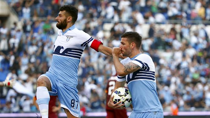 Lazio's Dordevic celebrates with his team mate Candreva after scoring against AS Roma during their Serie A soccer match at the Olympic stadium in Rome