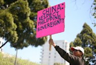 Anti-China protesters gather outside of the Consulate General of China in San Francisco on May 11. China has deployed more ships to a disputed shoal in the South China Sea amid a tense stand-off with the Philippines, officials and state media said on Wednesday