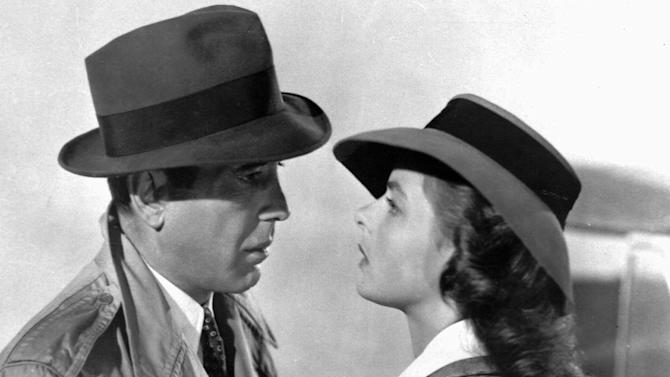 "FILE-This photo provided by Warner Bros.,  shows actors Ingrid Bergman and Humphrey Bogart in a scene from the film ""Casablanca.""   The piano used for the song ""As Times Goes By"" in the classic film is getting another turn at fame. The instrument is going up for sale at Sotheby's in New York on Dec. 14, 2012,  and the auction house estimates it'll fetch up to $1.2 million. It's being offered by a Japanese collector on the film's 70th anniversary.  Bogart played Rick Blaine in the Oscar-winning World War II love story, opposite Bergman's character, Ilsa Lund. In a famous flashback scene, Rick and Ilsa lean on the piano at a Paris bistro as Sam, played by Dooley Wilson, plays the piano and sings. (AP Photo/Warner Bros.)"