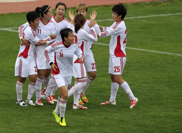 China's players celebrate their goal against Sweden during their women's Algarve Cup match in Parchal