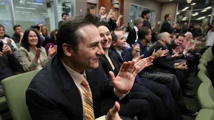 Gavin Maloof, co-owner of the Sacramento Kings, celebrates after the  Sacramento City Council approved a plan to help finance a new $391 sports and entertainment arena, in Sacramento, Calif., Tuesday, March 6, 2012.  By a 7-2 vote, the City Council approved a non-binding term sheet, signed off by the Kings and the NBA last week, that will keep the team in Sacramento for at least another 30 years. (AP Photo/Rich Pedroncelli)