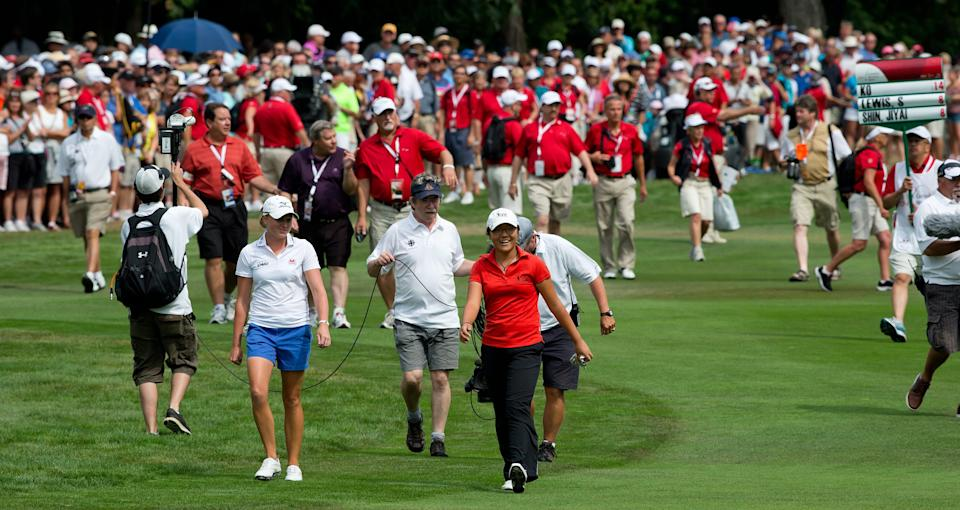 Lydia Ko, of New Zealand, walks up to the 18th green before going on to win the LPGA Tour's Canadian Women's Open golf tournament, Sunday, Aug. 26, 2012, at the Vancouver Golf Club in Coquitlam, British Columbia. (AP Photo/The Canadian Press, Darryl Dyck)
