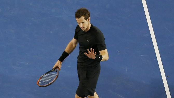 Andy Murray (top) of Britain gestures towards Nick Kyrgios of Australia after hitting a return near him during their men's singles quarter-final match at the Australian Open 2015 tennis tournament in Melbourne