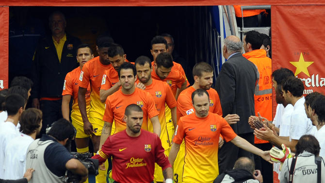 Espanyol players form a guard of honour to FC Barcelona prior to a Spanish La Liga soccer match at Cornella-El Prat stadium in Cornella Llobregat, Spain, Sunday, May 26, 2013. (AP Photo/Manu Fernandez)