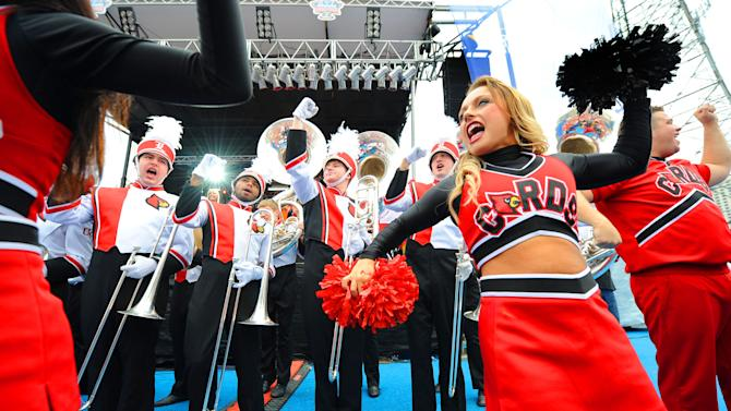 IMAGE DISTRIBUTED FOR ALLSTATE- University of Louisville marching band and cheerleaders excite Cardinals fans football fans at the school's pep rally at the Allstate Fan Fest in New Orleans, La., on Jan. 1, 2012. Louisville plays the Florida Gators in the 79th Sugar Bowl at the Mercedes-Benz Superdome on Jan. 2, 2012. (Cheryl Gerber/AP Images for Allstate) (Cheryl Gerber/AP Images for Allstate)