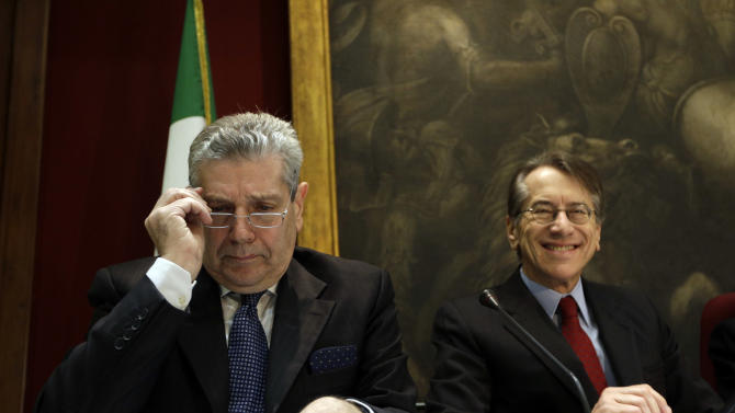 Italian Defense Minister Giampaolo Di Paola, left, and Foreign Minister Giulio Terzi, report on the ongoing situation in Mali to the foreign and defense commissions of the Senate and the Lower Chamber, in the Mappamondo Hall of the Lower Chamber, in Rome, Tuesday, Jan. 22, 2013. (AP Photo/Alessandra Tarantino)