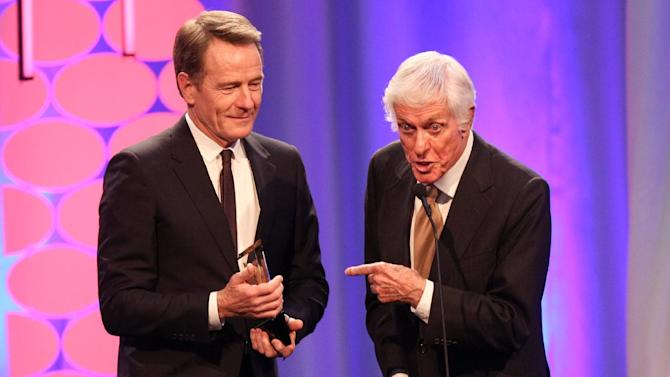 "Dick Van Dyke, right, presents Bryan Cranston with the award for Best Actor for ""Trumbo"" at the 15th Annual Movies for Grownups Awards at the Beverly Wilshire Hotel on Monday, Feb. 8, 2016, in Beverly Hills, Calif. (Photo by Rich Fury/Invision/AP)"