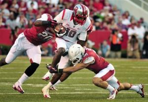 Nova's big day lifts Rutgers over Arkansas 35-26