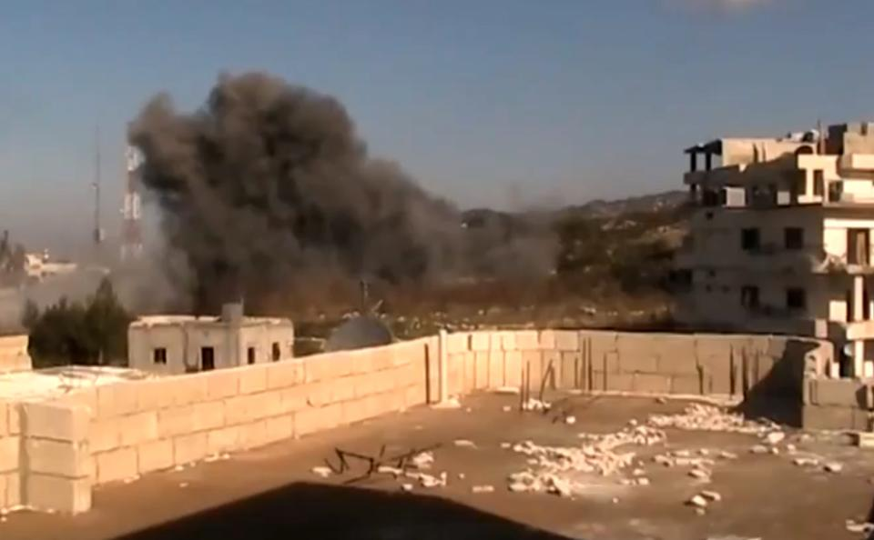 In this image taken from video obtained from the Shaam News Network, which has been authenticated based on its contents and other AP reporting, smoke rises from buildings due to heavy shelling in Latakia, Syria, on Monday, Jan. 14, 2012. (AP Photo/Shaam News Network via AP video)