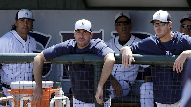 Detroit Tigers starting pitcher Justin Verlander, second from left, is seen in the dugout with teammate Doug Fister, right, during the first inning of an exhibition spring training baseball game against the Tampa Bay Rays, Friday, March 29, 2013 in Lakeland, Fla.Verlander agreed Friday to a $180 million, seven-year contract, topping Felix Hernandez for the richest deal for a pitcher in baseball history.  (AP Photo/Carlos Osorio)