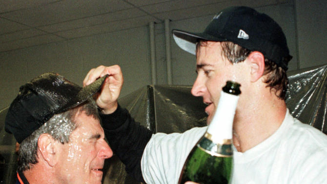 FILE - In this Oct. 4, 1999, file photo, New York Mets pitcher Al Leiter, right, places a doused cap manager Bobby Valentine's head in the locker room after their 5-0 win over the Cincinnati Reds in a baseball game for the National League wild card in Cincinnati. Leiter allowed only two hits in a 135-pitch shutout. The Associated Press takes a look at the nine one-game playoffs in major league history. (AP Photo/David Kohl, File)