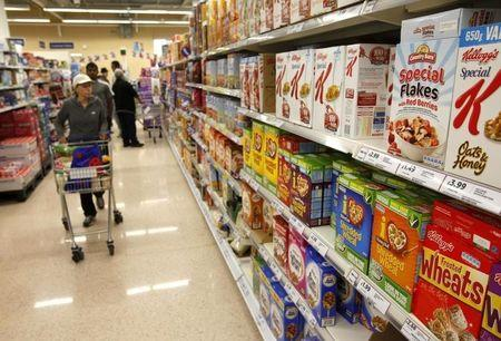Customers shop for groceries in a supermarket in London