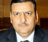 Syria's prime minister Riad Hijab, seen here in 2008, has joined the anti-regime revolt and fled abroad, in what Washington and the opposition hailed as a major blow to President Bashar al-Assad