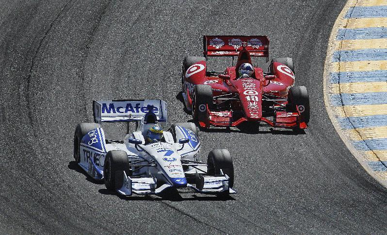 Sebastien Bourdais of France (7) leads Dario Franchitti of Scotland (10) during the IndyCar Series auto race Sunday, Aug. 26, 2012, in Sonoma, Calif. (AP Photo/Ben Margot)