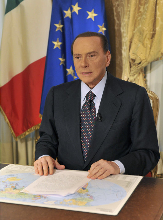 In this photo released by the Berlusconi press office Thursday, Oct. 25, 2012, former Italian premier Silvio Berlusconi tapes a video message where he announces he will not run for a fourth term as pr