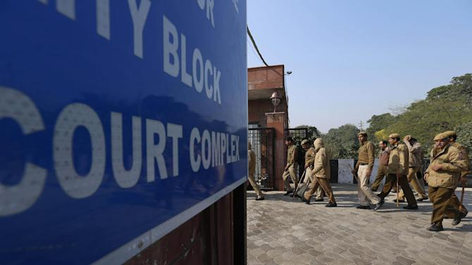 Policemen are deployed in a district court where the accused in a gang rape of a 23-year-old woman are to be tried, in New Delhi, India, Monday, Jan. 21, 2013. Legal proceedings in the fatal gang-rape attack on the student in India's capital were set to begin Monday in a fast-track court for crimes against women that has stirred debate over how best to deliver justice to rape victims. (AP Photo/Saurabh Das)