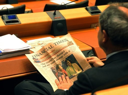 File picture shows a European deputy reading a copy of the Financial Times in the European parliament in Brussels in January 2009. British publisher Pearson said on Tuesday that its flagship business newspaper The Financial Times was not for sale, in response to recent media speculation.