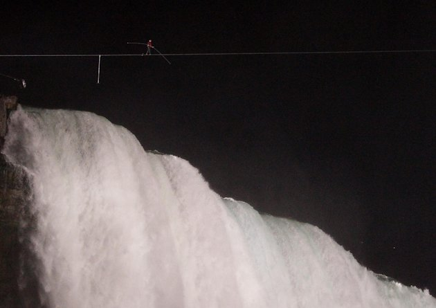 Nik Wallenda walks across Niagara Falls on a tightrope as seen from Niagara Falls, N.Y., Friday, June 15, 2012. Wallenda has finished his attempt to become the first person to walk on a tightrope 1,80