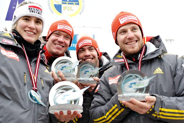 (L TO R) Germany's Natalie Geisenberger, Felix Loch, Tobias Wendl and Tobias Arltv celebrate after placing third in the Luge Team Relay event of the Luge World Cup in Sigulda on February 19, 2012. Ita