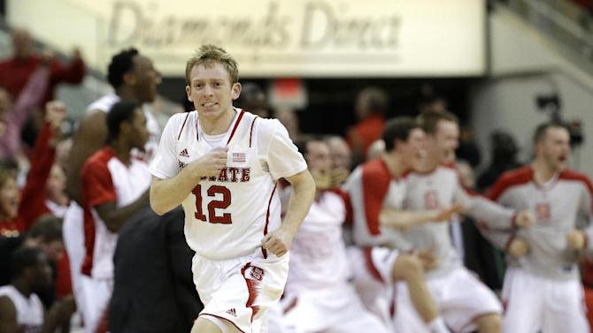 North Carolina State's Tyler Lewis (12) reacts during the second half of an NCAA college basketball game against North Carolina in Raleigh, N.C., Wednesday, Feb. 26, 2014. North Carolina won 85-84 in overtime. (AP Photo/Gerry Broome)