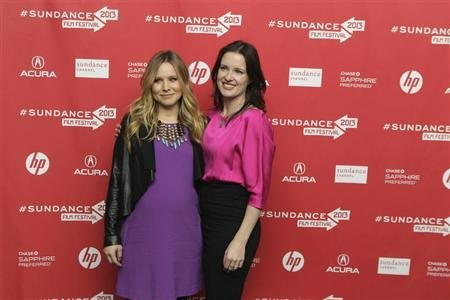 "Actress Kristen Bell arrives with Director Liz Garcia (R) for the premiere of the film ""The Lifeguard"" during the Sundance Film Festival in Park City, Utah, January 19, 2013. REUTERS/Lucas Jackson"