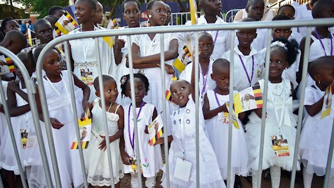 School children wait for Pope Francis to arrive at Lubaga Cathedral in Kampala on November 28, 2015