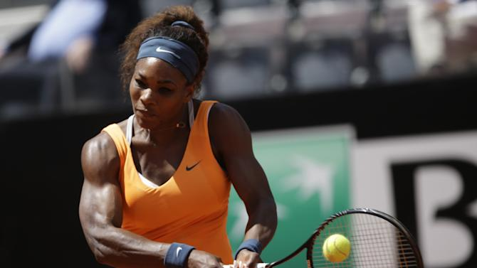US Serena Williams returns the ball to Belarus Victoria Azarenka during their final match at the Italian Open tennis tournament in Rome, Sunday, May 19, 2013. (AP Photo/Andrew Medichini)