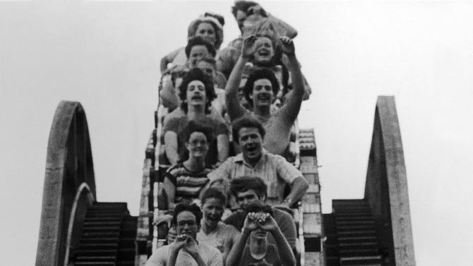"""FILE - In this July 22, 1981 file photo, visitors ride The Beast roller coaster at Kings Island amusement park in Mason, Ohio. The Beast opened in 1979 and will soon give its 50 millionth ride. Kings Island expects that to happen during Friday night's """"Halloween Haunt"""" activities at the park. (AP Photo, File)"""