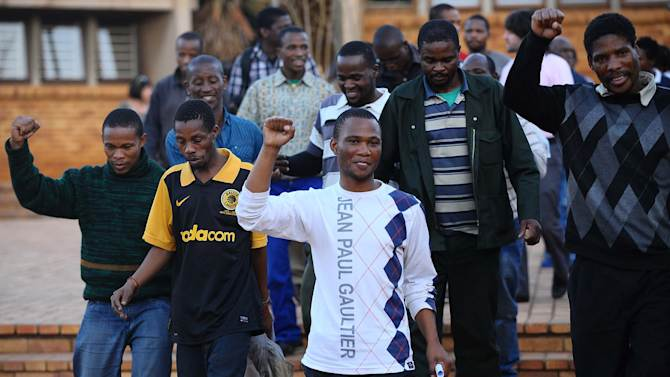 Mine workers celebrate their release at Ga-Rankuwa Magistrate's Court, Pretoria, South Africa, Monday, Sept. 3, 2012. The miners were among those arrested for public violence after the police opened fire on a group of striking mineworkers killing 34 and wounding 78 at Lonmin's Marikana platinum mine on August 16.Last week, prosecutors said the men arrested would be charged with the murder and attempted murder of their colleagues. Following a public outcry the charges were provisionally withdrawn on Sunday. (AP Photo)