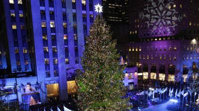 Stars help light Rockefeller Center tree