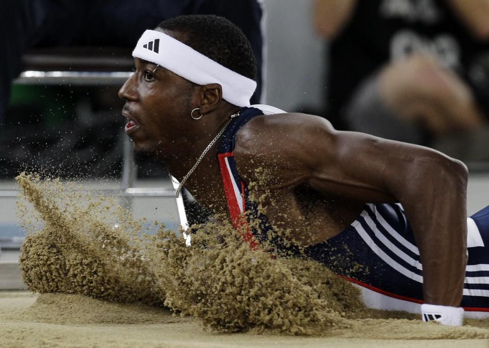 Britain's Phillips Idowu makes an attempt in the Men's Triple Jump final at the World Athletics Championships in Daegu, South Korea, Sunday, Sept. 4, 2011. (AP Photo/David J. Phillip)