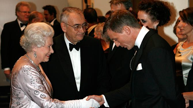 """FILE - In this Nov. 14, 2006 file photo, Britain's Queen Elizabeth II, left, meets actor Daniel Craig, the new James Bond, during the world premiere of the latest James Bond movie """"Casino Royale"""" at the Odeon cinema in Leicester Square in London. (AP Photo/Stephen Hird, Pool, File)"""