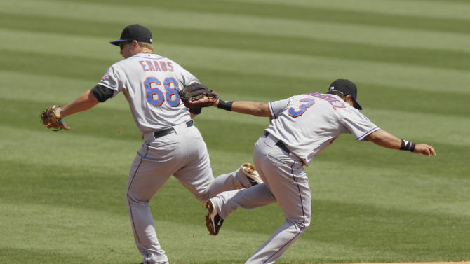 New York Mets second baseman Brad Emaus (68) and teammate Luis Hernandez (3) cross paths as Emaus chases the single by Florida Marlins shortstop Hanley Ramirez during the fourth inning of a spring training baseball game, Sunday, March 20, 2011, in Jupiter, Fla. (AP Photo/Carlos Osorio)