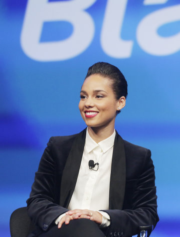 Singer Alicia Keys, the Global Creative Director of Blackberry, appears Wednesday, Jan. 30, 2013, in New York. The maker of the BlackBerry smartphone is promising a speedy browser, a superb typing experience and the ability to keep work and personal identities separate on the same phone, the fruit of a crucial, long-overdue makeover for the Canadian company. (AP Photo/Mark Lennihan)