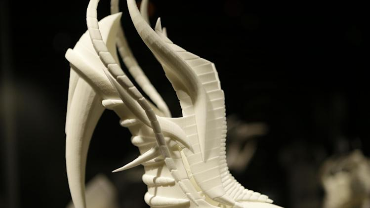 "This Feb. 11, 2013 photo shows Janina Alleyne's ""Exoskeleton"" shoe on display at the ""Shoe Obsession"" exhibit at The Museum at the Fashion Institute of Technology Museum in New York. The exhibition, showing off 153 specimens, runs through April 13. (AP Photo/Kathy Willens)"