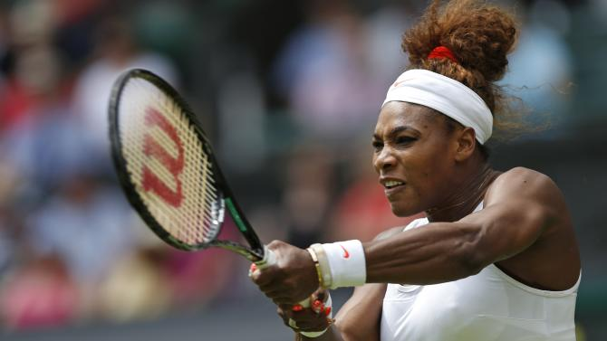 Serena Williams of the United States returns the ball to Mandy Minella of Luxembourg during their Women's first round singles match at the All England Lawn Tennis Championships in Wimbledon, London, Tuesday, June 25, 2013. (AP Photo/Sang Tan)