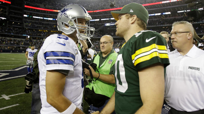 Dallas Cowboys quarterback Tony Romo (9) and Green Bay Packers quarterback Matt Flynn (10) greet after an NFL football game, Sunday, Dec. 15, 2013, in Arlington, Texas. Green Bay won 37-36. (AP Photo/Tim Sharp)