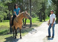 This photo taken Aug. 7, 2012 shows Sara Weaver, left, and her husband, Marc, at their ranch outside Kalispell, Mont. Sara Weaver has finally forgiven the federal agents who 20 years ago shot her mother and younger brother to death during the siege at Idaho's Ruby Ridge. (AP Photo/Nicholas K. Geranios)