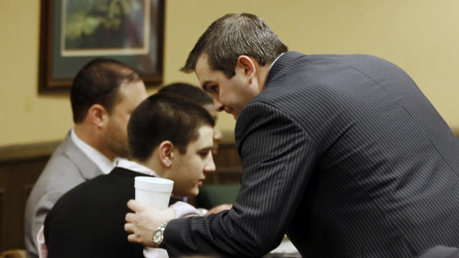 Trent Mays, 17, left, talks with one of his defense lawyers, Brian Duncan before the start for the fourth day of his and co-defendant 16-year-old Ma'lik Richmond's trial on rape charges in juvenile court on Saturday, March 16, 2013 in Steubenville, Ohio. Mays and Richmond are accused of raping a 16-year-old West Virginia girl in August, 2012. (AP Photo/Keith Srakocic, Pool)
