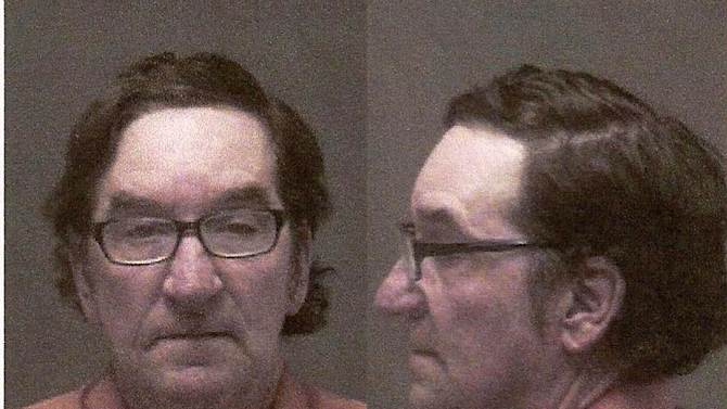 This booking photo provided by the Isabella County Sheriff's Department shows John D. White. White was arraigned Thursday, Nov. 1, 2012, in Mount Pleasant, Mich., on first-degree murder charges and ordered jailed without bond. The 55-year-old ex-convict has confessed to beating and strangling a 24-year-old neighbor as part of a sexual fantasy, hiding her naked body and then returning to her central Michigan trailer home and helping her 3-year-old son get costumed for Halloween, authorities said Thursday. (AP Photo/Isabella County Sheriff's Department)