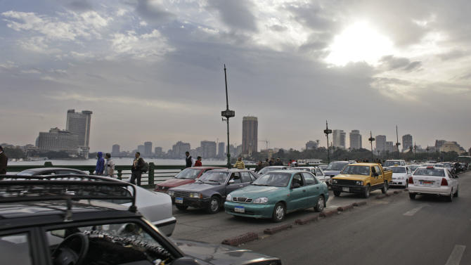 Traffic returns to the Kasr El-Nil bridge leading to Tahrir Square in downtown Cairo, Egypt Sunday, Feb. 6, 2011. A sense of normalcy began to return to some parts of the capital Sunday, which has been largely closed since chaos erupted shortly after the protests began on Jan. 25. (AP Photo/Ben Curtis)