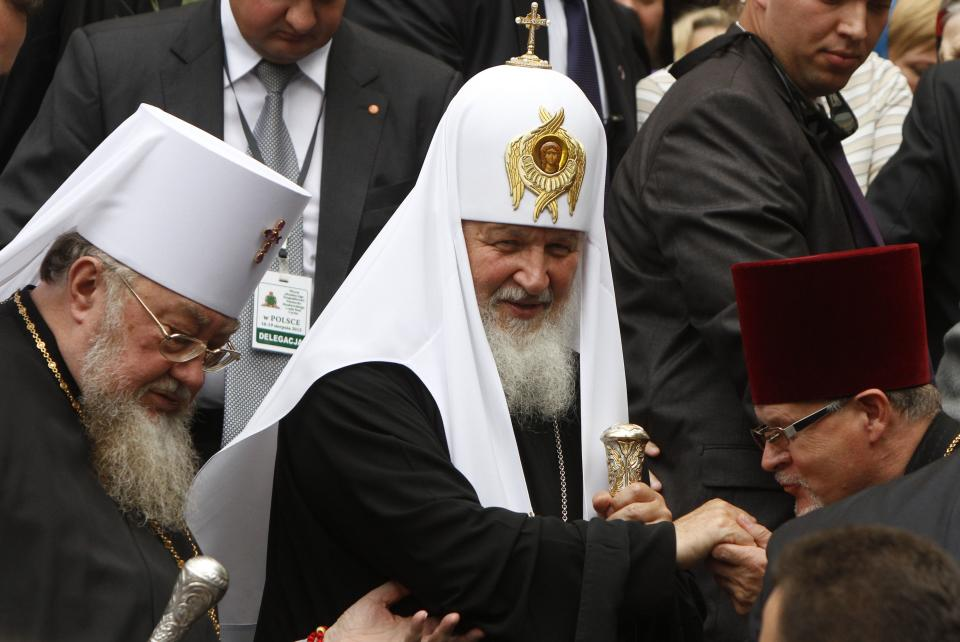 Patriarch Kirill , leader of the Russian Orthodox Church, centre, smiles after a Mass at the orthodox St. Mary Magdalene Cathedral in Warsaw, Poland, Thursday, Aug. 16, 2012. Patriarch Kirill came to Poland for a four-day official visit. (AP Photo/Czarek Sokolowski)