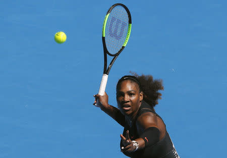 Serena marches on to fourth round