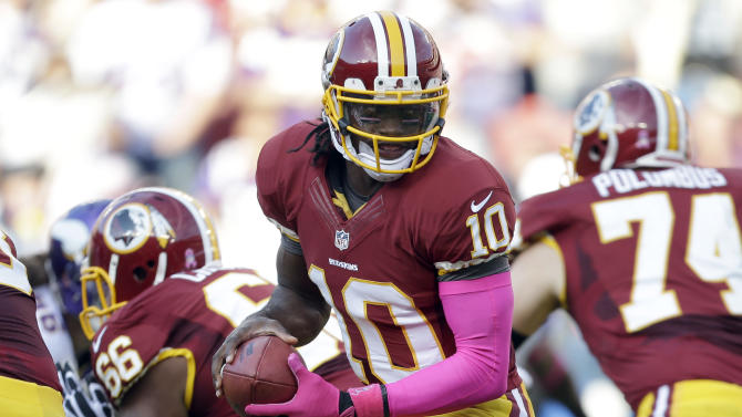 Washington Redskins quarterback Robert Griffin III (10) turns with the ball during the first half of an NFL football game against the Minnesota Vikings, Sunday, Oct. 14, 2012, in Landover, Md. (AP Photo/Pablo Martinez Monsivais)