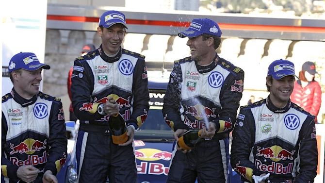 World champion Sebastien Ogier of France, second right, and his co driver Julien Ingrassia of France, second left, steering a Volkswagen Polo R, spray champagne after winning the 83rd Rally of Monte Carlo, with Jari Matti Latvala of Finland,, left, second of the race and Andreas Mikkelsen of Norway, third place, right, Sunday, Jan. 25, 2015, in Monaco. The Rally of Monte Carlo is the first event of the 2015 WRC calendar. (AP Photo/Lionel Cironneau)