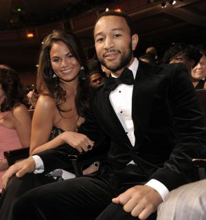 File- This Feb. 26, 2010 file photo shows John Legend, right, and Christine Teigen at the 41st NAACP Image Awards in Los Angeles. Legend is officially off the market. The R&B crooner's representative said Legend married Teigen on Saturday Sept. 14, 2013 at the Villa Pizzo in Lake Como, Italy. Legend, 34, and Teigen, 27, were engaged in 2011. (AP Photo/Chris Pizzello, File)